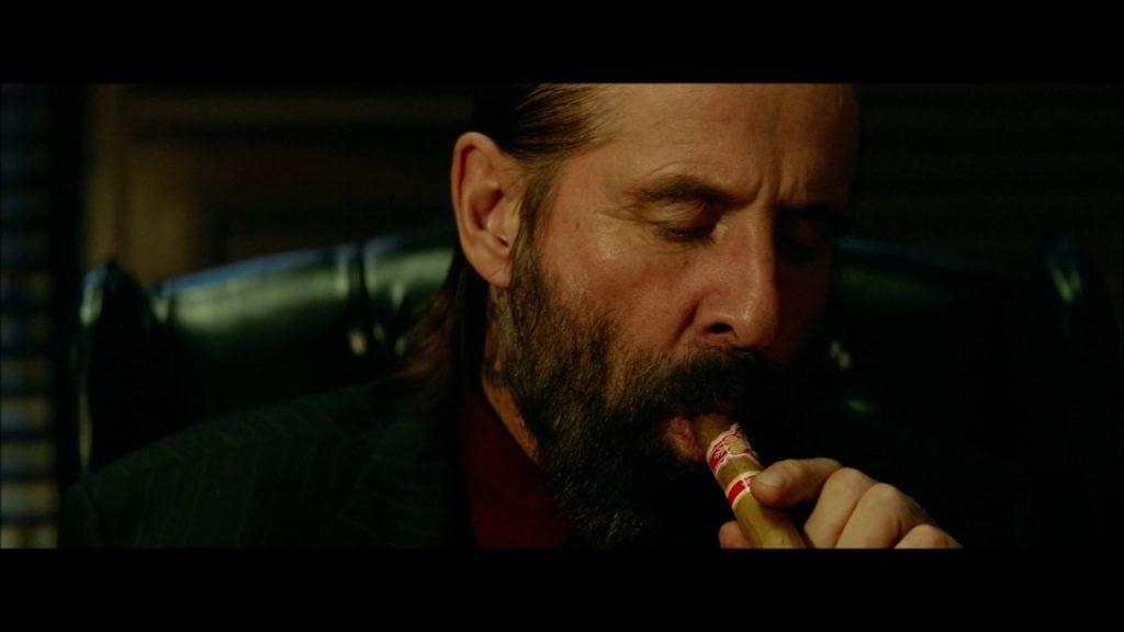 در فیلم John Wick: Chapter 2 به طور تقریبی نیمی از فیلم صرف مأموریت جان برای دینی است که به گردن دارد و نیمه دوم فیلم صرف تصویه حساب شخصیه وی با سانتیو میشود.